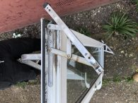 Replacement of window hinges Erith BEFORE, see below for after